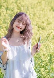 亚洲油菜花花海美女摄影高清图片